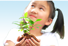 Young girl holdling a plant in her hands